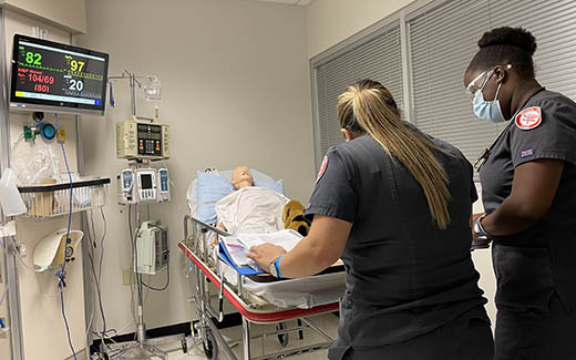 UNT Nursing students practicing in a training hospital environment