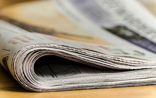 Newspaper on tabletop